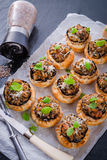 Champignons with puff pastry. A Champignons with puff pastry Royalty Free Stock Photography