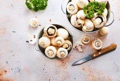 Champignons. Raw mushrooms in metal bucket, champignons in bucket Royalty Free Stock Photography