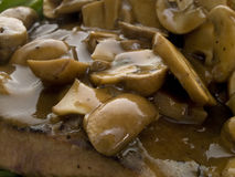 Champignons with sauce Stock Photo