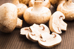 Champignons on the wooden table Stock Photography