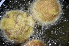 Champignons stuffed with cheese and sausage mixture, coated in flour, bread crumbs and fry in a pot. Champignons stuffed with cheese and sausage mixture, coated Royalty Free Stock Image
