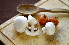 Champignons and tomatoes Stock Image