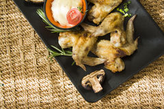 Champignons and wings Stock Photo
