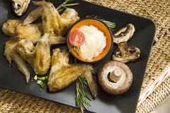 Champignons and wings Stock Image