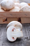 Champignons in a wooden box on old table Royalty Free Stock Images