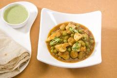 Champinjoncurry med Rumali Roti Royaltyfri Bild