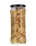 Champinjoner marinaded (champignons) i den glass kruset Royaltyfri Fotografi