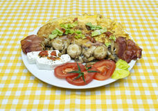 Champinjoner och ägg för frukost Fotografering för Bildbyråer