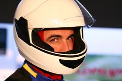 Champion. Closeup portrait of racer in helmet royalty free stock images