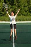 The champion. Action shot of boy winning tennis Stock Image