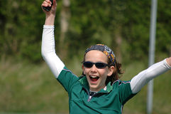 The champion. Girl shouting with joy after winning tennis match Royalty Free Stock Photography