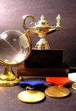 Champion around the World. A globe, trophy, and three medals royalty free stock photo