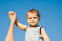 Champion baby. Little boy with raised hand royalty free stock image