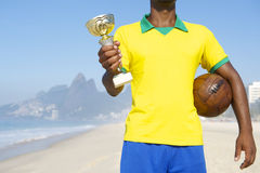 Champion Brazilian Footballer Holding Trophy and Soccer Ball Royalty Free Stock Photo