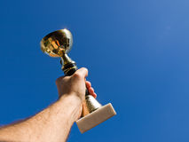 Champion, concept. Trophy in the hand of man Stock Image