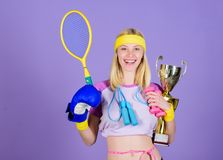 Champion concept. Girl sport instructor hold golden goblet of winner or champion. Woman good in tennis jumping boxing. Fitness sport. She is best in all royalty free stock photos
