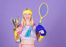 Champion concept. Girl sport instructor hold golden goblet of winner or champion. Woman good in tennis jumping boxing. Fitness sport. She is best in all stock images