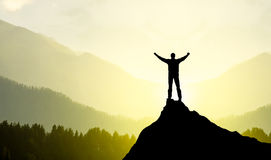 Champion concept. Champion on mountain peak. Sport and active life royalty free stock photography
