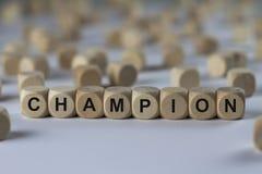 Champion - cube avec des lettres, signe avec les cubes en bois Image stock