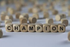 Champion - cube with letters, sign with wooden cubes Stock Image