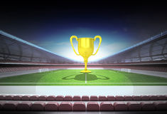 Champion cup in midfield of magic football stadium Royalty Free Stock Image