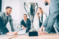 champion cup standing on table at conference hall royalty free stock images