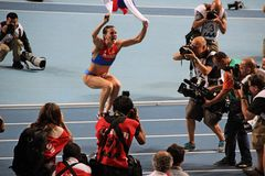 Champion E. Isinbayeva jumping with Russian flag Stock Photography