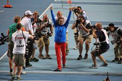 Champion E. Isinbayeva and paparazzi Royalty Free Stock Image