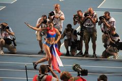 Champion E. Isinbayeva with Russian flag Stock Photo