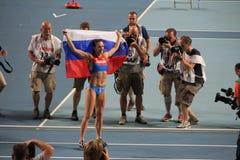 Champion E. Isinbayeva with Russian flag Royalty Free Stock Image