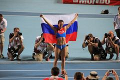 Champion E. Isinbayeva with Russian flag Royalty Free Stock Photography