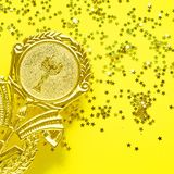 Champion gold cup trophy on yellow background. minimalism style, victory celebration concept. and golden stars of. Champion gold cup trophy on yellow background stock image