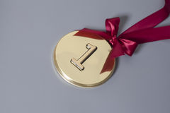 Champion Gold Medal with red ribbon Royalty Free Stock Images
