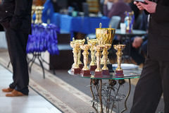 Champion golden trophies. Cup for the first place.  royalty free stock photo