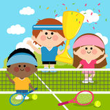 Champion kids tennis players at tennis court holding trophy Royalty Free Stock Photo