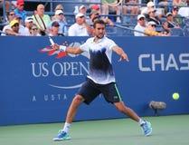 Champion Marin Cilic de l'US Open 2014 de Croatie pendant le match 4 rond de l'US Open 2014 Image stock
