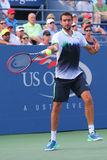 Champion Marin Cilic de l'US Open 2014 de Croatie pendant le match 4 rond de l'US Open 2014 Photo libre de droits