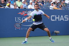 Champion Marin Cilic de l'US Open 2014 de Croatie pendant le match 4 rond de l'US Open 2014 Photos stock