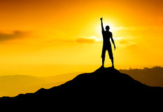 Champion. On the mountain top. Sport and active life concept stock photography