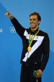 Champion olympique Gregorio Paltrinieri de l'Italie pendant la présentation de médaille au ` s d'hommes style libre de 1500 mètre Photos libres de droits