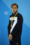 Champion olympique Gregorio Paltrinieri de l'Italie pendant la présentation de médaille au ` s d'hommes style libre de 1500 mètre Photographie stock libre de droits
