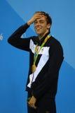 Champion olympique Gregorio Paltrinieri de l'Italie pendant la présentation de médaille au ` s d'hommes style libre de 1500 mètre Photo libre de droits