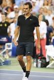 Champion Roger Federer de Grand Chelem de dix-sept fois après victoire au match 4 rond à l'US Open 2014 Images libres de droits