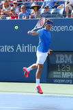 Champion Roger Federer de Grand Chelem de dix-sept fois pendant son premier match de rond à l'US Open 2013 Photo stock