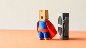 Champion super hero won first place. Successful leadership conceptual photography. Brave wooden clothespin peg character. Red blue suit, vintage letterpress Royalty Free Stock Photos