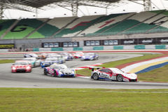 Champion Team Weider leads the pack into turn 2 Stock Photography