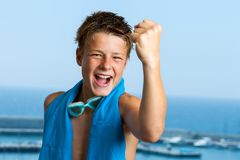 Champion teen swimmer pulling a fist. Portrait of champion teen swimmer showing positivity Stock Images
