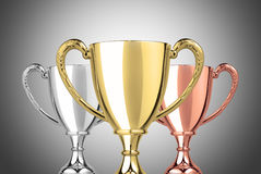 Champion trophies. Close up champion golden silver and bronze trophy on gray background stock illustration