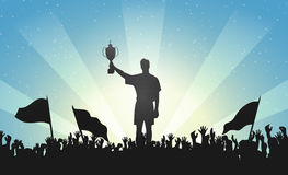 Champion with a trophy in crowd of people Royalty Free Stock Photos