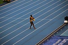 Champion Usain St. Leo Bolt dancing on the treadmill royalty free stock photo